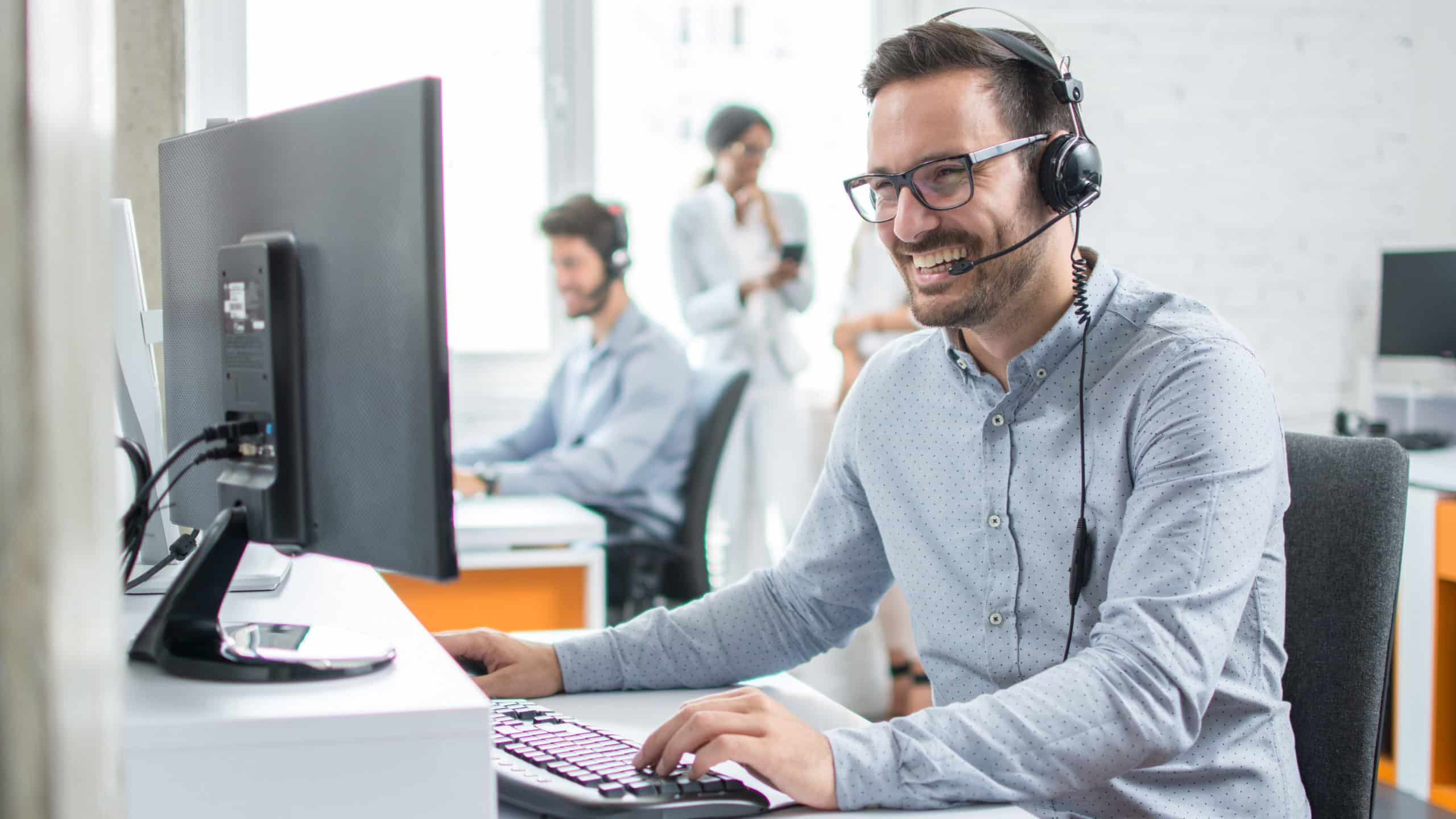 Smiling customer service representative on the phone with a customer; Start your career in trucking and logistics to not only learn more about the industry, but to also become a better employee by gaining new skills, learning to deal with new tasks daily, and to open new opportunities for yourself.